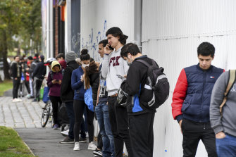 International students and others who didn't qualify for government support queue in Melbourne's Southbank for food charity in April, 2020.