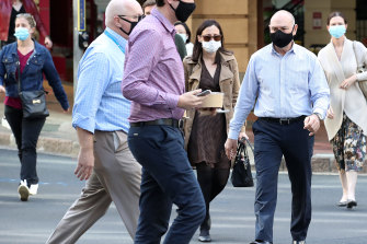 Masks will stay for at least another week in affected parts of Queensland, but experts say the extension signals a change in how health authorities are managing outbreaks.
