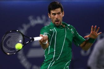 Novak Djokovic of Serbia in action against Philipp Kohlschreiber of Germany at Dubai.