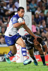 Verve: Will Hopoate palms off Te Maire Martin as he looks to start an attack from deep in the Bulldogs' half.