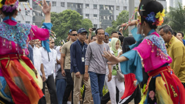 On track for re-election: President Joko Widodo arrives for the opening of Jakarta's first mass-transit system.