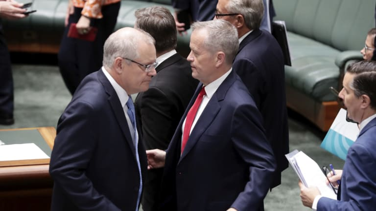 Prime Minister Scott Morrison and Opposition Leader Bill Shorten cross paths during a tense final sitting day of the year.