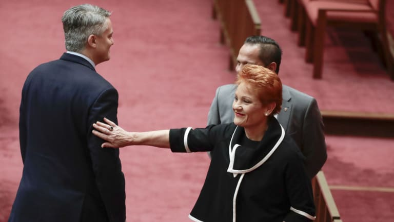 Finance Minister Mathias Cormann and One Nation leader Pauline Hanson part ways after the government's company tax cuts were voted down on Wednesday.