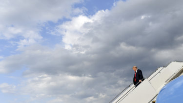 US President Donald Trump walks down the steps of Air Force One.