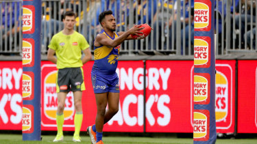 Sheer Will power: West Coast's Willie Rioli caps a sublime display of skills with a goal against North Melbourne.