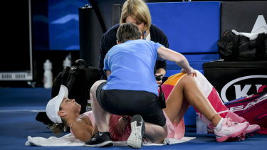 Barty receives treatment during a medical time-out in her third-round clash.