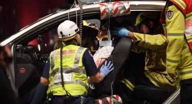 A re-enactment of a car crash scenario allows paramedics to develop skills.