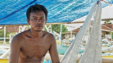 Oli, a fisherman from Kedonganan fishing village on his fishing boat.
