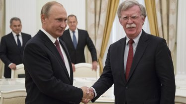 Vladimir Putin, meets John Bolton in Moscow on Wednesday.