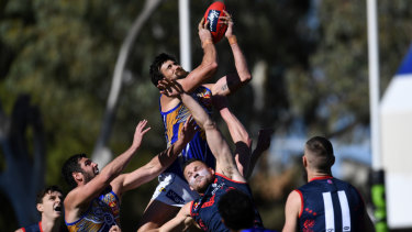 High flier: West Coast forward Josh Kennedy rises above the pack.