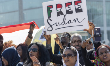 People demonstrate at a solidarity rally for Sudan at the Place des Nations in front of the European headquarters of the United Nations in Geneva on Friday.