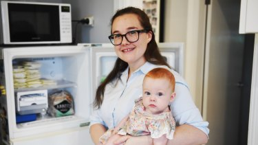 Penny Pearce, who has donated about 18 litres of breast milk - enough to feed 400 babies, with her daughter Vivian.