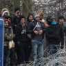 Greece fires tear gas at migrants after Turkish border 'onslaught'