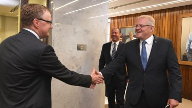 The PM and the Treasurer meet the governor of the Reserve Bank.