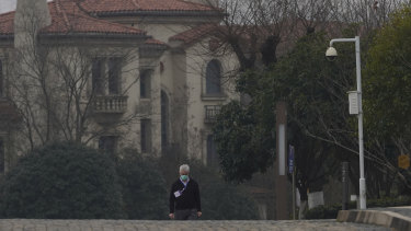 Dominic Dwyer of a World Health Organisation team walks in the cordoned hotel area in Wuhan.