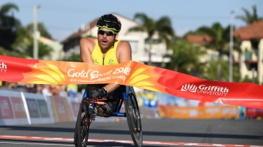Kurt Fearnley of Australia wins the Mens T54 Marathon during the XXI Commonwealth Games.