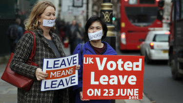 Pro-Brexit demonstrators outside the Houses of Parliament in London.