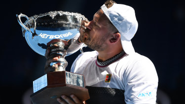 Dylan Alcott savours the prize after winning the quad wheelchair singles final.