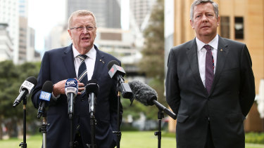 President of the Australian Olympic Committee John Coates speaks to the media with Australian Olympic Committee chief executive Matt Carroll last year.