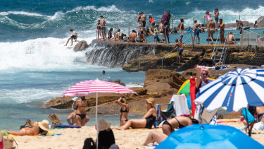 Crowds gathered at Bronte Beach on Friday as huge surf battered the ocean pool.