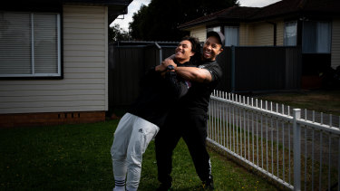 Jarome Luai with his father Martin outside their Dharruk home last year.