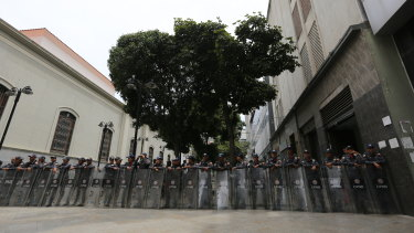 Venezuelan security forces form a cordon around the opposition-controlled congress in Caracas, blocking access to MPs and the public.