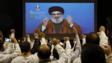 Hezbollah leader Hassan Nasrallah, via a video link seen in southern Beirut, Lebanon.