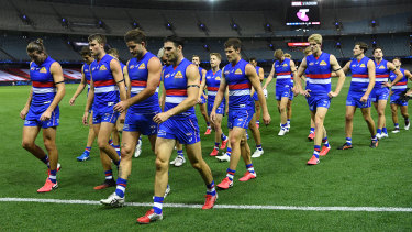 The Western Bulldogs trudge off the field after their round one loss to Collingwood.
