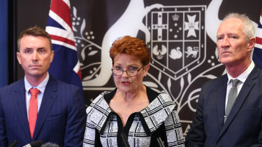 Queensland senator and One Nation leader Pauline Hanson, flanked by party officials James Ashby and Steve Dickson on Thursday.