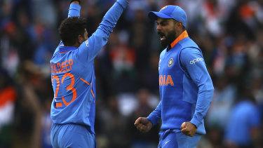 India's Kuldeep Yadav (left) and Virat Kohli celebrate the wicket of Pakistan's Fakhar Zaman.