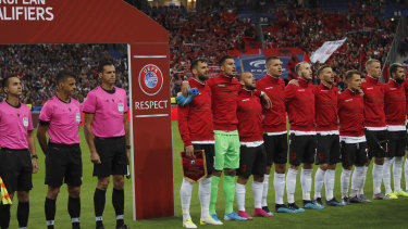 Albania stand for their national anthem after the wrong one had been played earlier.