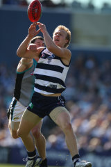 Nathan Ablett marks in front of Port's Micheal Pettigrew.