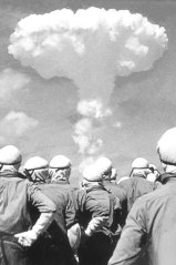 People observe atomic bomb explosion in an undated photo.