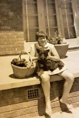The writer in 1959, aged 11, with her Scottie dog, Flora, and pups in the family egg basket.