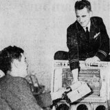 Dr. T. Hurley hands the myanesin to Flt. Lt. Keith Martin, pilot of the mercy plane.