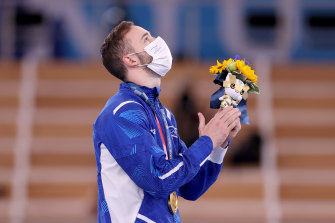 Artem Dolgopyat on the podium after winning Israel's second-ever Olympic gold medal and first in artistic gymnastics.