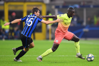 City's Benjamin Mendy (right) battles for possession with Atalanta's Marten de Roon.
