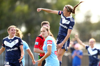 Melbourne Victory's Amy Jackson, right, celebrates a goal at CB Smith Reserve.