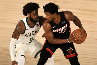 Jimmy Butler (right) will play in the NBA conference finals for the first time after his Miami Heat swept aside Milwaukee 4-1 to advance to the final four for the first time since 2014.