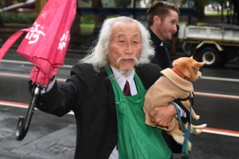 Activist Danny Lim with his chihuahua-pomeranian dog Smarty outside Downing Centre Local Court in Sydney on Friday,