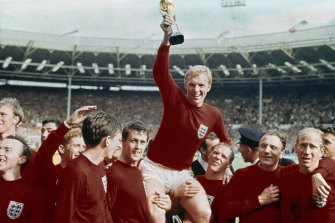 England captain Bobby Moore is carried by teammates Geoff Hurst, center left, and Ray Wilson after England beat Germany in the World  Cup final in 1966.