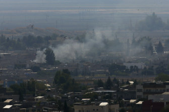 Plumes of smoke could be seen rising from Ras al-Ayn in Syria.