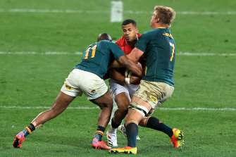 Anthony Watson of the British & Irish Lions is tackled by Peiter-Steph du Toit (R) and Makazole Mapimpi.