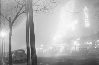 Collins Street blanketed in fog.