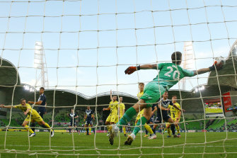 Rudy Gestede heads the ball into the net.