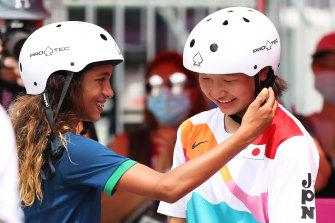 Rayssa Leal of Brazil, also 13, greets Momiji Nishiya during the women's street skateboard final in Tokyo.