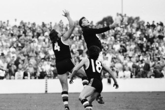 Tony Lockett and Steven Silvagni compete in the air.