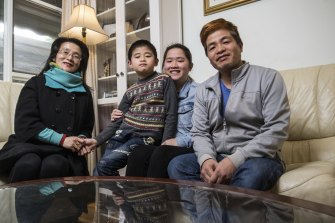 It's back to school for Jennifer Ou, centre, and brother Justin, 8, pictured with parents Irene and Ken.