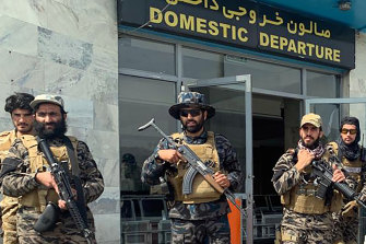 Taliban fighters stand guard inside the Hamid Karzai International Airport after the US withdrawal in Afghanistan.