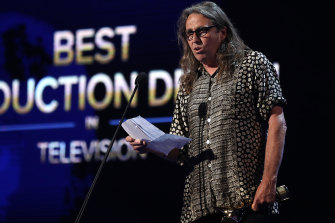 Chris Kennedy accepts the AACTA Award for best production design in television.
